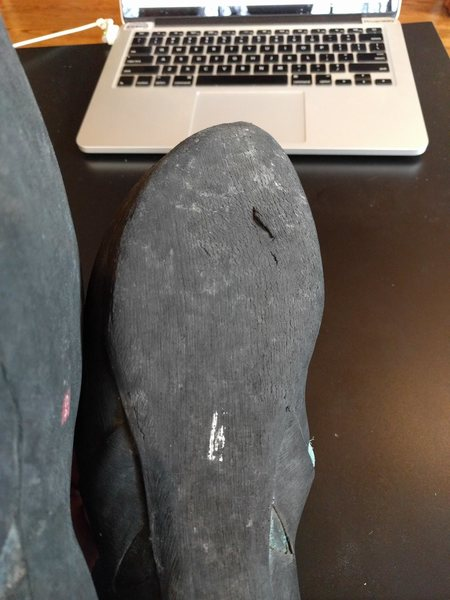 Close up of wear on bottom of shoe.  Needs resole.