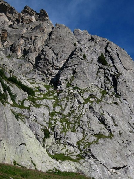 NE Ridge of Spazzacaldera is the shadowed right slanting arête in the upper middle part of the view.  A party starting the route can be seen in the middle of the photo.