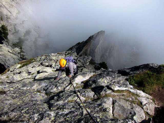 Racing the fog to the top of the NE Ridge of Spazzacaldera