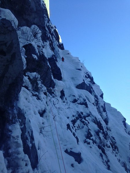 This photo is of us traversing up to the single rappel to reach the base of Twisted Sister and Big Brother.
