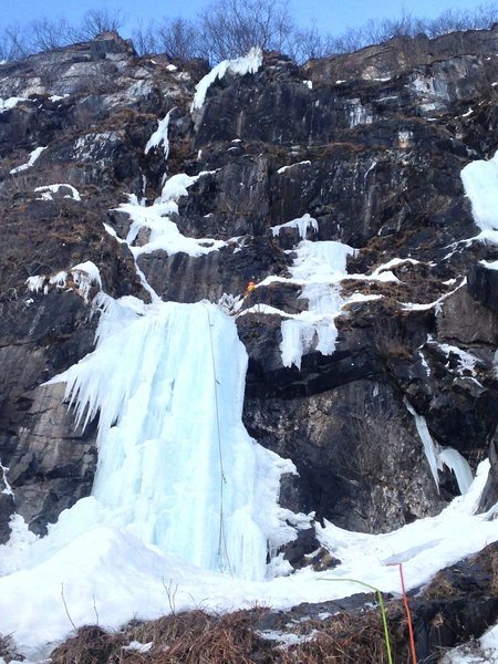 Cut left on this ledge and keep climbing into the hanging ice at above the climber.