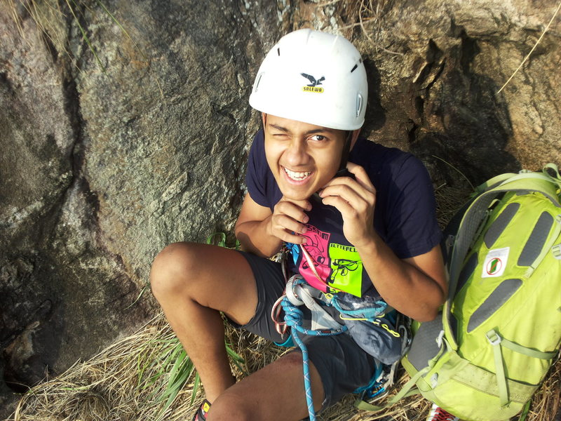 Bharath's debut into multi-pitch climbing. Prepping for leading P3, sitting on the belay ledge of P2.