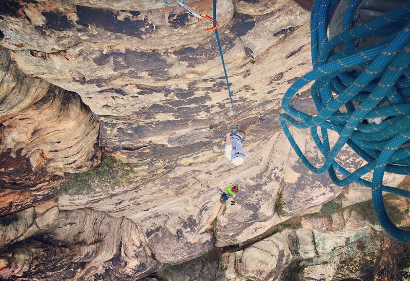 Accidentally belaying from the rappel anchors.