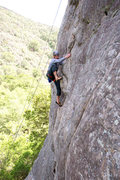Rock Climbing Photo: Past the crux, Ian makes a high step towards easie...