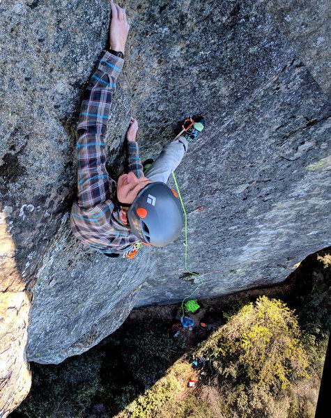 Rock Climbing Photo: Dylan Sjostrom pulls the thin lie backing near the...