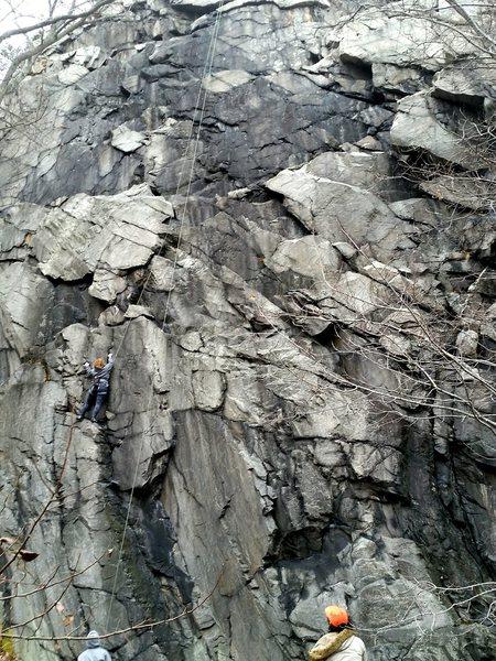 Climber on Cliff Monster