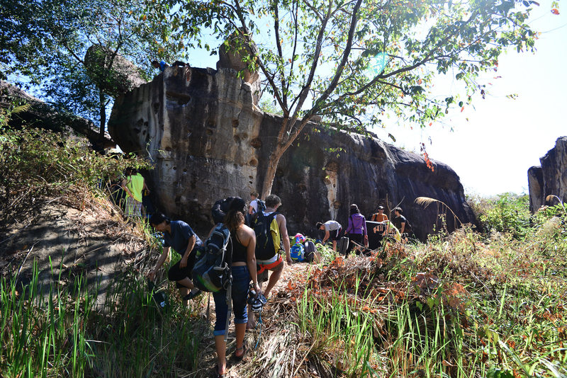 Climbers heading to &@POUND@39@SEMICOLON@Diamond Boulder&@POUND@39@SEMICOLON@, Lower Meadow area, His Chang Si, Nam Pong National Park,during the 1st Khon Kaen bouldering festival Jan 2017