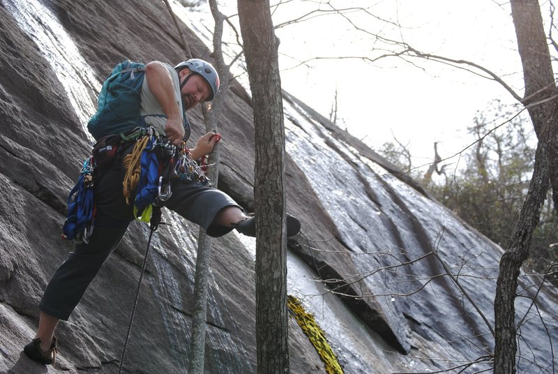 Scouting the route from a tree stem. I tried slinging the tree to protect the crux, but the swing would not have been fun so I pulled it sharp.