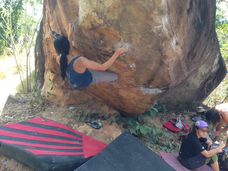 Mean (Puntarika) Thai female top climber on Pinker Tips, T-Rex boulder, Khon Kaen