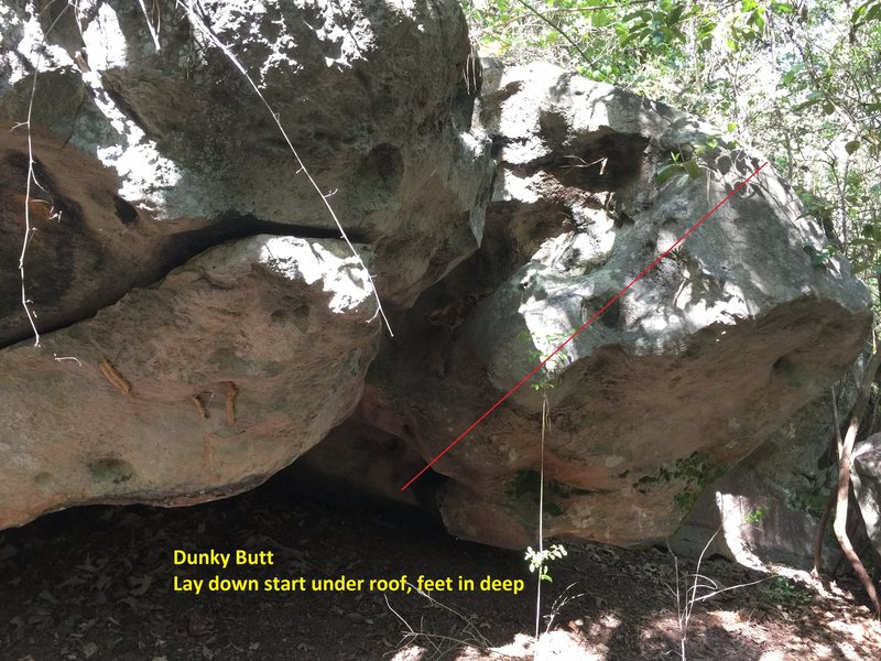 Lay start way under the boulder, work out to the mushroom bulge, then work up and left to corner (not straight up)