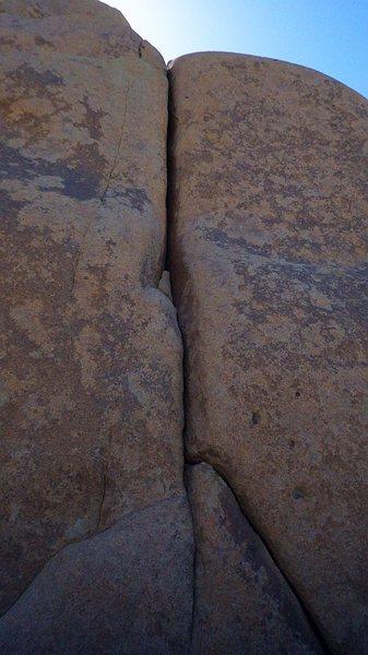 Rock Climbing Photo: Undocumented hand to fist crack halfway between th...