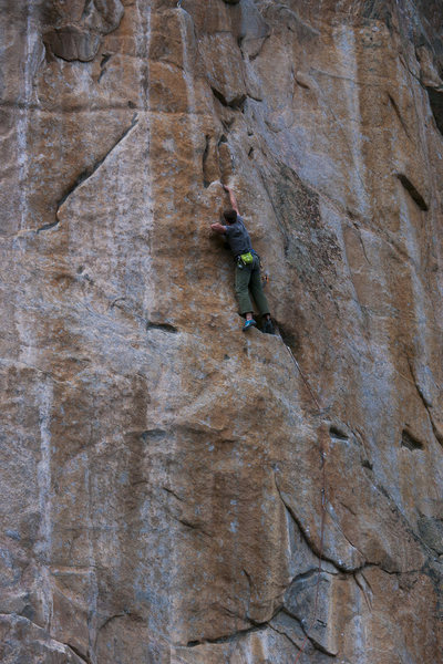 Skyler sticking the amazing double pocket feature at the end of the middle crux.