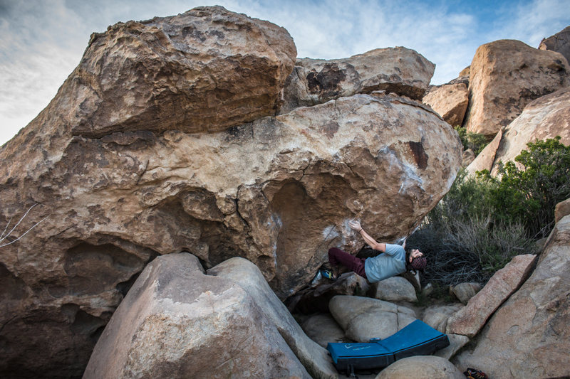 Nicholas Rondilone setting up for the crux throw. Photo by Megan Tumbleson