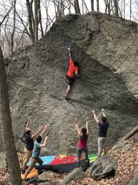 A high left foot to reach the sliver sidepull before the crux.