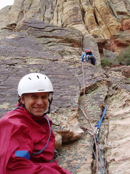 (Route Photo) WHY is this man smiling? As the wise, old climber he is: he&@POUND@39@SEMICOLON@s managed to belay, not lead, the crux pitch. (Note the all-nut trad belay.)