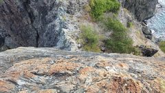 Rock Climbing Photo: Looking down the cliff below the bolt at Ram Head....