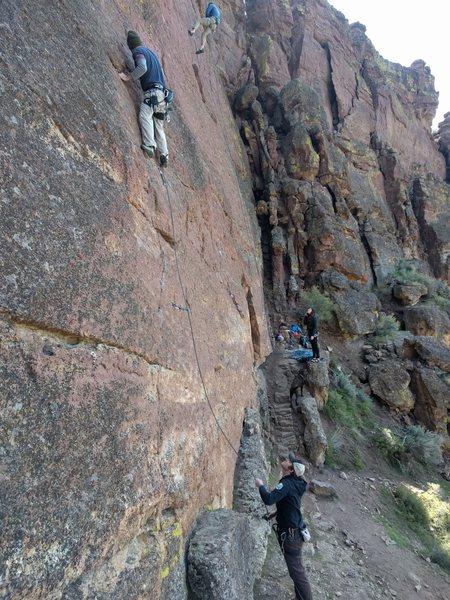 Rock Climbing Photo: Clipping the third bolt.