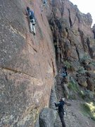 Rock Climbing Photo: Clipping the third bolt.