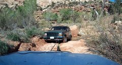 Attempting to winch Jeep completely high centered in ruts