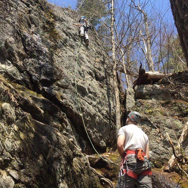 Tom belaying Me climbing
