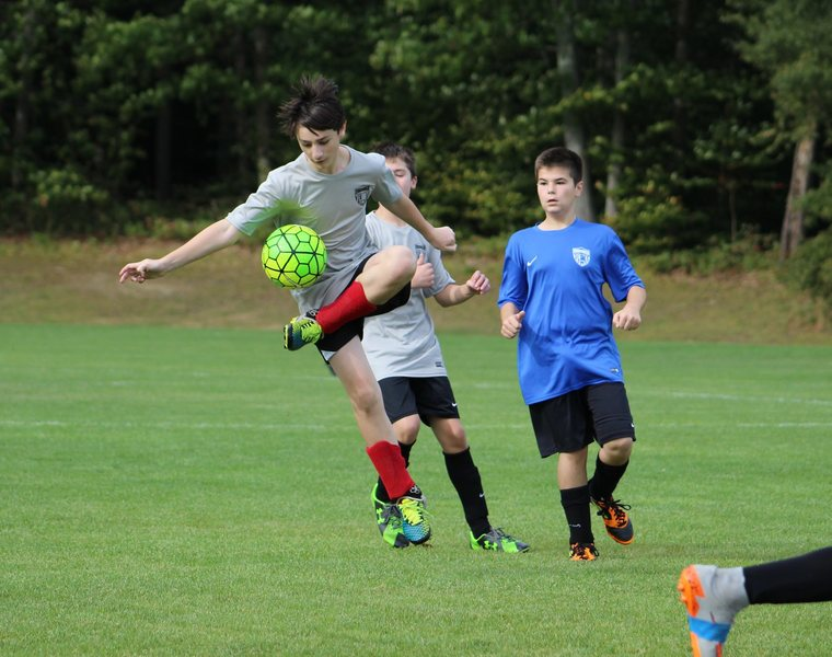 Zachary in charged of the ball during a soccer game. 2014