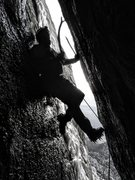 Rock Climbing Photo: Myles Moser leading the crux mixed chimney on Bad ...