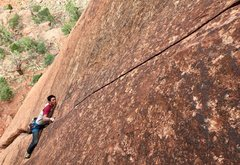 Rock Climbing Photo: Dennis Lim. Preparing for a long long finger crack...