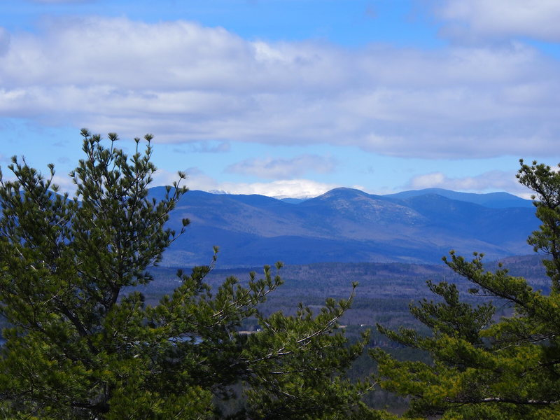 Great Views from the Summit (hiking trail on the 'north' side).  The white, cloud-like Mtn dead center is Mt Washington.