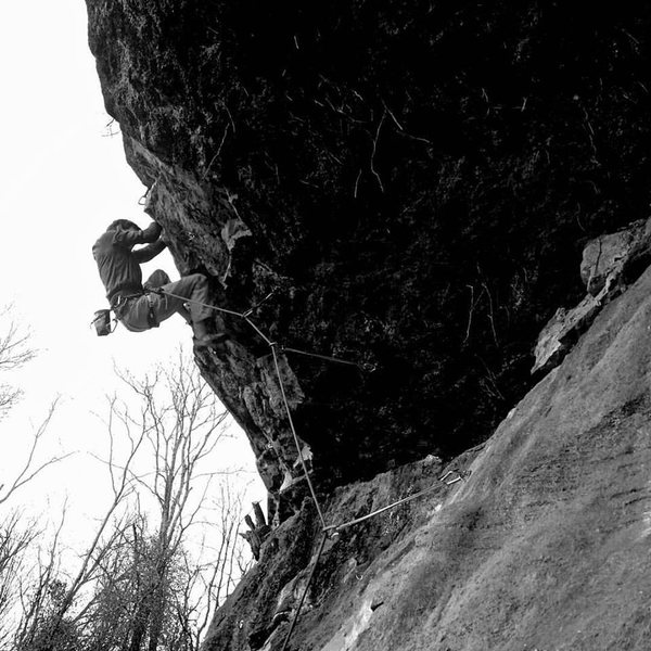 Climber pulling through the crux of The Butcher.