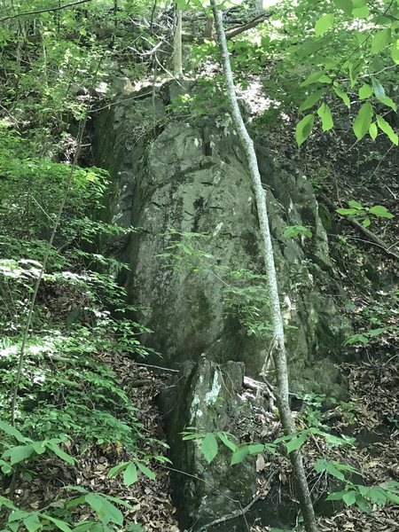 Further down the creek to the right.  Pretty overgrown but an option if you want to deal with the brush.  Probably better with a top rope due to angle of climb and very jagged approach.  Est 5.6-5.7