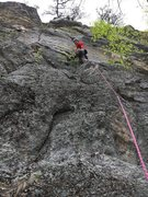 """I'm right below the crux flake on Back to the Future. The mysterious """"pointy overhang"""" is obvious, up at the top of the photo, over my head and a little bit left of center."""
