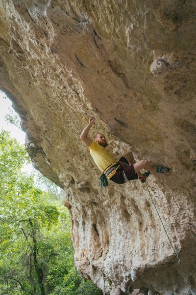 Trying not to blow the crux.<br> <br> Photo by Travis Perkins