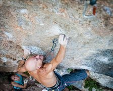 Andy Shields reaches through the crux of &#39;Yurtle the Turtle&#39; <br /> <br />Photo by Du Lo