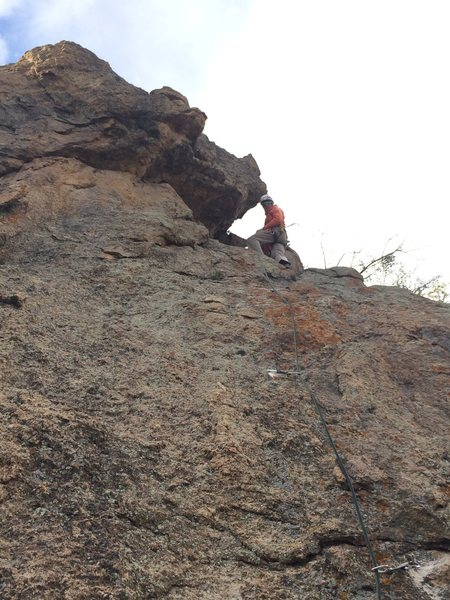 Mike Lewis on the first bolted ascent and at the anchors on Magic Ear Muffs.