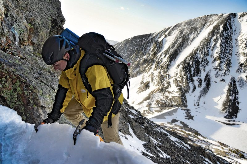 Pulling onto the snow ledge/crevasse at the base of the route.