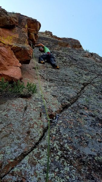 The crucial second piece of protection is the #1 Camalot. Easy climbing above with much wider gear. Matt cruising the first ascent.