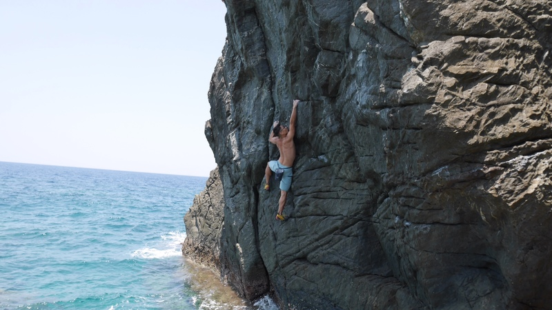 Jasen reaching for shelf before crux
