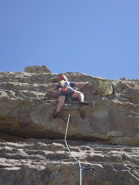 Shae at the crux (note extra nut placement between her legs)