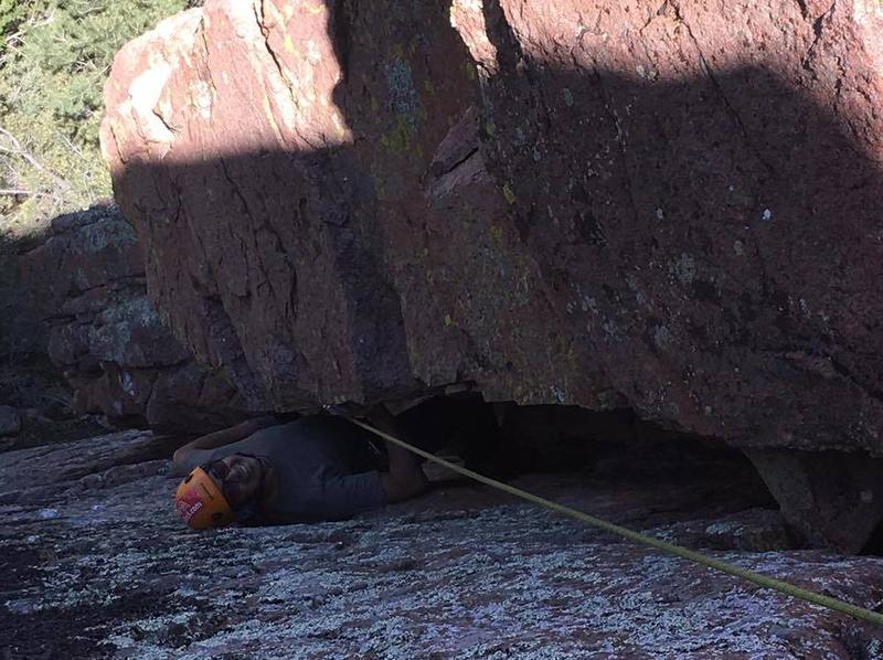 Crawling out of the final roof of the Maw. Matt Johnson belaying and photo.