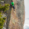 The last bit of 5.11 arete climbing with rad position.