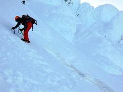 Rock Climbing Photo: Darwin crossing the snow bridge over the bergschru...