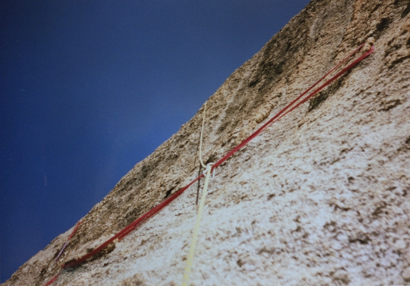 Above the step up bolt two horns slung with a narrow long piece of webbing. Difficult and time consuming for had to get tight so would not slip off the right side was good for body weight and a little head way but still questionable. The sling on the left high I backed off of. First ascent photo