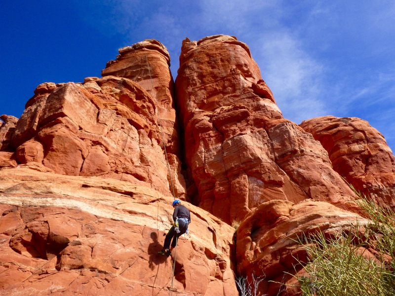Nate Heald rappelling down the southwest face.