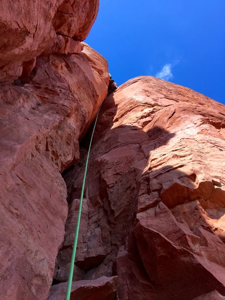 Leading the offwidth. Photo taken from first ledge en route.