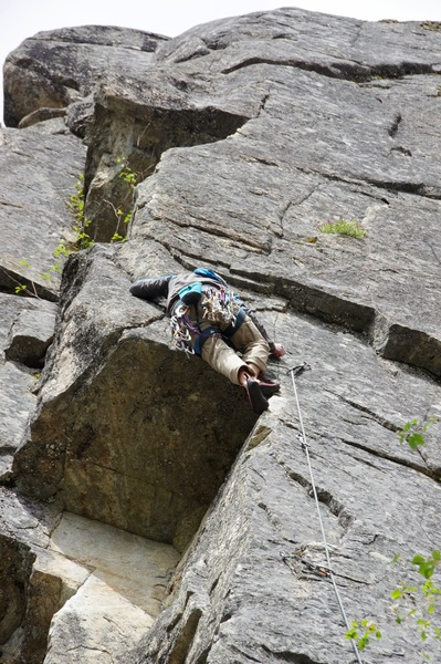 Climber showing how the crux is done.
