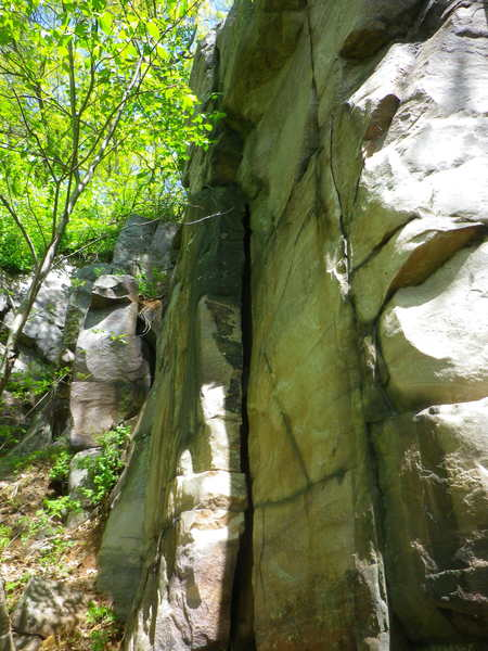 Climb up crack and continue pass overhang.