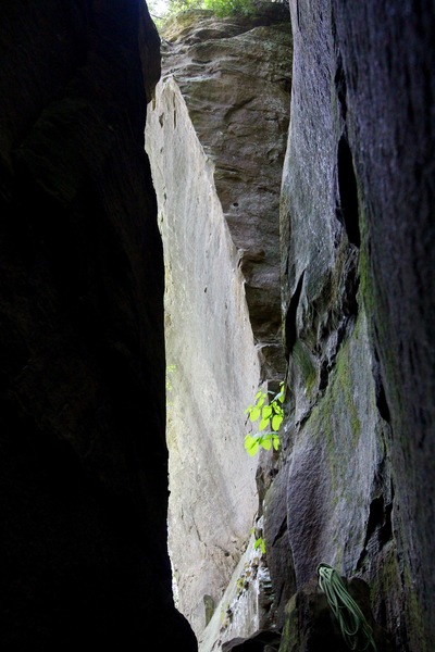 A look through the corridor at the striking arête of Pay the Devil, 5.13b