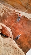Rock Climbing Photo: Dano rappelling Praying Monk South Face, Brianna a...
