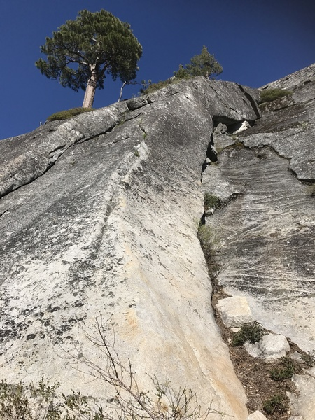 HMR-6 goes up the low angled arete, through the steeper rock above then up an easy slab to Mussy hook anchors.