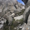 Overview of upper half (shot from mother of pearl).  You can see the rest alcove, the rising traverse, and the offwidth.